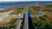 příjezdová cesta : Aerial road bridge above river. Top view cars and truck moving on highway bridge. Aerial view of straight highway road above river. Drone view of automobile traffic on bridge above river Dostupné videozáznamy