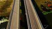 road top view : Car bridge over river. Drone view of highway bridge above river. Cars and truck driving along highway bridge. Highway road on river landscape. Cars moving on road aerial view