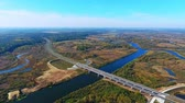 příjezdová cesta : Highway road bridge over river. Aerial view of road bridge over water. Drone view of highway road landscape. Highway bridge. View from above. Road over river landscape