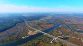 příjezdová cesta : Aerial view of bridge over river and highway road. Drone view of road bridge over water. River aerial view. Aerial landscape. Highway road bridge over river. Drone view of highway road landscape