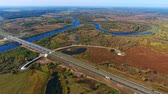 вид сверху : Drone view highway landscape. Highway road above river landscape aerial. Landscape bridge road from birds view. Aerial view road in nature landscape. Aerial highway. Aerial road in field