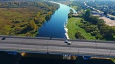 příjezdová cesta : Aerial highway road above river. View from above beautiful river water landscape. Aerial landscape bridge over river water. Aerial bridge road in river nature landscape. Road bridge aerial view