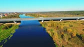 üst : Aerial view highway above beautiful river water. Landscape highway road above river. Car bridge over river landscape aerial. Drone view bridge road above river. Highway bridge aerial view Stok Video