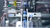 gyógyszertár : Packaging line at pharmaceutical factory. Pharmaceutical industry. Medical drugs on packaging machine. Pharmaceutical manufacturing packaging process. Pharmaceutical packaging