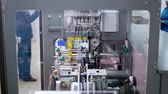 pharmaceutical factory : Pharmaceutical factory conveyor belt. Pharmaceutical industry conveyor line. Pharmaceutical manufacturing line. Pharmaceutical production line Stock Footage