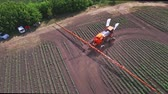 fertilizer field : Irrigation agriculture machine. Agricultural sprayer moving on farming field and making watering plant. Sky view process irrigating agricultural field using fertilizer spreader. Fertilizer agriculture