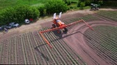 farming machinery : Agriculture fertilizer spreader. Spraying machine on agricultural field. Drone view agricultural sprayer on farming field after work. Fertilizer agriculture for irrigation field Stock Footage