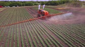 fertilizer field : Process irrigation on farming field using agriculture fertilizer. Drone view agriculture fertilizer working on cultivated field. Fertilizer agriculture. Agriculture spraying. Pesticide spraying