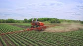 fertilidade : Agriculture irrigation machine. Agricultural machinery watering field. Farming agriculture machine for irrigation field. Agriculture industry work. Agricultural machinery