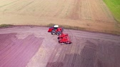 hospodářství : Agricultural tractor with trailer ploughing on agricultural field. Farming tractor plowing farming field. Drone view agricultural machinery on farming field. Agricultural industry. Agriculture aerial