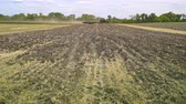 arando : Farming tractor working on agricultural field. Agricultural tractor plowing field. Agricultural equipment working on arable field. Plowed land. Agricultural industry. Plowed field