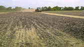 arando : Agricultural tractor moving on field. Farming tractor working on agricultural field. Plowed field. Farming machinery. Agricultural industry. Rural field