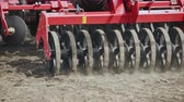 husbandry : Sowing machine working on farming field. Close up soil sowing process. Agricultural equipment for field sowing. Farming machinery. Agricultural technology. Agriculture machinery parts Stock Footage