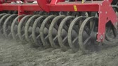 sows : Process sowing plowed field with sowing equipment. Seeders sowing machine. Modern sowing machine working on farming field Stock Footage