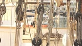 Ropes holding sail on yacht boat. Ropes on deck sea yacht. Rope equipment on sailing yacht. Yacht deck