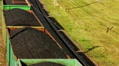 kargo : Industrial train transporting petroleum products on rail road. High view freight train transporting coal on railway