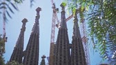 Panoramic view of La Sagrada Familia cathedral in Barcelona city. Low angle view of old catholic church in modern European city. Barcelona city sightseeings. Historical building by Antonio Gaudi Wideo