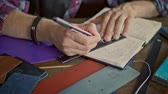 caderno : Leather maker drawing sketch in notebook. Sketch for leather product. Leather manufacturer working on sketch in workshop Stock Footage