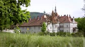 bástya : Grey castle building on green meadow. Old architecture palace on green grass. Vintage house on green lawn
