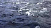 waterway : Fast water stream background. Close up of blue waves flow. Flowing river water surface. Deep water flowing. Blue wave background Stock Footage