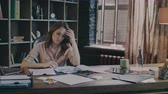 papírování : Serious businesswoman sitting at table and trying find solution of business problem. Worker woman doing market research. Tired employee analyse business data on document. Business woman thinking