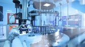 pharmaceutical factory : Pharmaceutical manufacturing line. Pharmaceutical machinery with ultraviolet light for quality control of medicine vials at medical factory. Medical vials at production line. Pharmaceutical industry Stock Footage