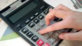 bookkeeper : Woman using calculator. Business accounting and money profit calculation. Close up of business woman hand using calculator at office. Female accountant calculate numbers. Family budget calculation