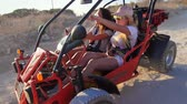 travel cage : Female driver ride on buggy car. Enjoy extreme riding. Tourists driving dune buggy. Extreme holiday. Women drive on sand buggy car. Girl driving dune transport