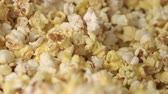 kernels : Fresh hot popcorn mixing in popcorn machine. Popcorn background. Close up of popcorn production in slow motion. Cinema pop corn background Stock Footage