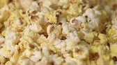 kernels : Mixing hot popcorn in heap. Close up of fresh popcorn flakes. Popping up pop corn. Process of popcorn production. Fresh corn flakes. Cinema food concept. Pop corn background