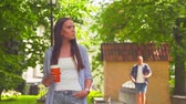 late spring : Girl awaiting her boyfriend in a park. Man delaying to date. Love and relations. Stock Footage