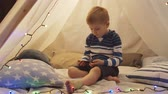 오두막 : Little boy playing in childrens tent at home. Happy caucasian kid in the playroom. 무비클립