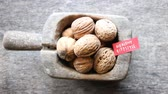 nozes : Healthy lifestyle - inscription on the label and and walnuts. Stock Footage