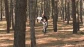 vintage : Father and son running through woods with paper airplane and than launch it. Slow motion. Little boy playing paper airplane with his father in wood