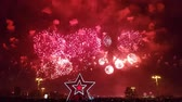 işler : Gorgeous colorful fireworks on Victory Day. Crowd of people watching fireworks. Moscow, Russia.
