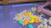 Childs hands playing with colorful magisk sand. Happy childhood concept. Young children background. Vidéos Libres De Droits