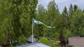 Beautiful view of swedish flag on the top of roof on green trees background. Sweden Europe Vidéos Libres De Droits
