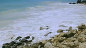 Gorgeous view of turquoise waves of Atlantic Ocean breaking on stones. Beautiful nature landscape backgrounds. Aruba island. Atlanta. Stockvideo