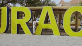 Big yellow capital letters Curacao along a road in the center of Willemstad, the capital of Curacao. Willemstad. Curacao. 09092019. Stockvideo