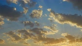 небесный : Beautiful cloudscape with large, building clouds and sunrise breaking through cloud mass.