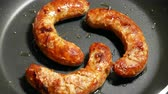 well done : Overhead Closeup frying link sausage fast food in cast iron skillet Stock Footage