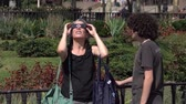 human eye : A woman looks at a solar eclipse through glasses Stock Footage