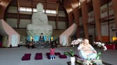 приукрашивание : Woman praying in front of Buddha statue, Chuang Yen Monastery