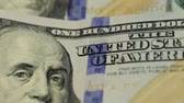 franklin : Cash money background. Benjamin Franklin portrait on 100 US dollar bill close up, the image is rotated