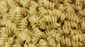 Prepared spiral pasta blurred closeup Стоковые видеозаписи