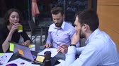 paper : Meeting between business people on a table Stock Footage
