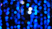 seasonal : City lights abstract circular bokeh on blue background Stock Footage