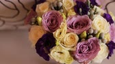 bloom : Beautiful wedding flower bouquet. Close up. Yellow, pink and purple bridal bouquet