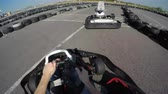 karting : two drivers drive go kart and overtaking on outdoor track, camera is attached to the helmet, Man drives go kart on track, Karting filmed from the drivers view