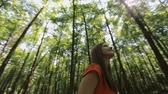 snění : beautiful girl in a red dress walking through the forest.Slow motion